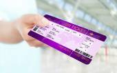 Hand holding air ticket on airport — ストック写真