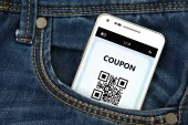 Mobile phone with discount coupon in pocket — Foto Stock