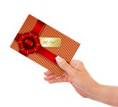 Hand holding gift card isolated over white  — Stock Photo