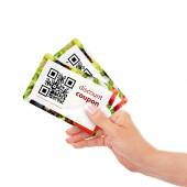 Hand holding two  discount coupons with qr code isolated over wh — Foto Stock