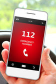 Hand holding mobile phone 112 emergency number — ストック写真