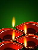 Diwali oil lamps over green background — Stok fotoğraf