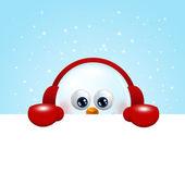 Snowman with earmuffs holding christmas blank  — Stock Photo