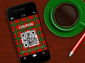Mobile phone with christmas coupon, cup of coffee and pencil — Stok fotoğraf