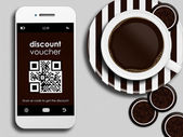 Mobile phone with discount coupon, cup of coffee and gingerbread — Stockfoto