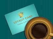 coffee with loyalty card lying on tablecloth — Stockfoto