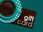 coffee with gift card lying on tablecloth — Stock Photo