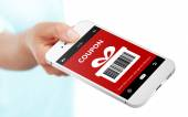 Hand holding mobile phone with christmas coupon over white — Stock Photo
