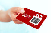 Gold christmas coupon holded by hand over white  — Stock Photo