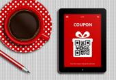 Tablet with discount coupon and  cup of coffee lying on tableclo — Stock Photo