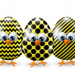 Easter yellow and black eggs isolated over white — Stock Photo #65352409