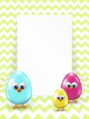 Easter eggs and white blank over zigzag background — Stock Photo