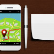 Mobile phone with gps application, pen and clean note lying on d — Stock Photo #66624629