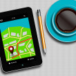 Tablet with gps navigation application, coffee and pencil lying — Stock Photo #66667859