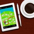Tablet with gps navigation application, coffee and pencil lying — Stock Photo #66667941