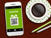 Mobile phone with spring discount coupon, coffee and pencils — Stock Photo