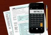 U.s. individual income tax return form 1040 with phone calculato — Stock Photo