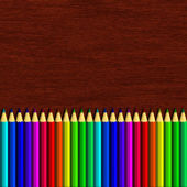Colour pencil lying on wooden table — Stock Photo