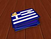 Greek credit cards lying on desk — Stock Photo