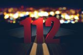 112 emergency number standing on the road — Stock Photo