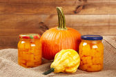 Preserved autumn vegetables on shelf in wooden wall — Stockfoto