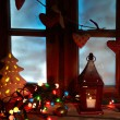 Frosted window with Christmas decoration — Stock Photo #58506513