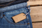 Blue jeans texture and price tag — Stock Photo