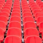 Bright red stadium seats — Stock Photo #64075693
