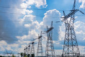 Pylon and transmission power line in summer day — Stock Photo