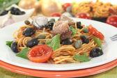 Spaghetti alla puttanesca with capers — Stock Photo