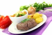Roasted ostrich steaks with baked potatoes — Photo