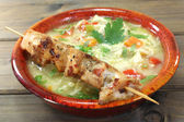 Chicken soup with chicken skewers and noodles — Stock Photo