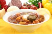 Soljanka in a soup bowl with pickles — Stock Photo