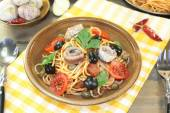 Spaghetti alla puttanesca with olives, capers and anchovies — Stock Photo