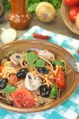Spaghetti alla puttanesca with olives and anchovies — Stock Photo