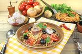 Spaghetti alla puttanesca with capers and tomatoes — Stock Photo