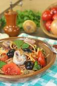 Spaghetti alla puttanesca with anchovy and tomatoes — Stock Photo