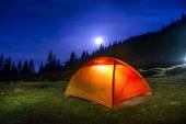 Illuminated orange camping tent — Stock Photo