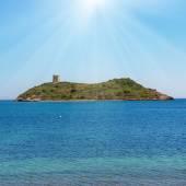 Cozy tropical island in blue sea — Stock Photo