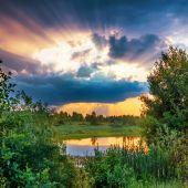Beautiful sunset above lake — Stock Photo