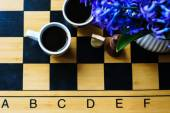 Chess and coffee — Stock Photo