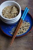Rice and chopsticks — Stock Photo