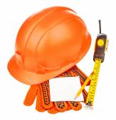 Construction helmet with measure tape and gloves on white backgr — Stock Photo