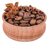 Coffee, cinnamon and star anise in a wooden bowl isolated on whi — Stock Photo
