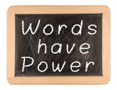The phrase Words Have Power written in white chalk on a used bla — Stock Photo