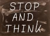 The phrase Stop and Think written on a blackboard as a reminder  — Stock Photo