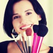 Young make-up artist woman holding brushes — Stock Photo #52569919