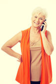 An old woman talking through phone. — Stock Photo