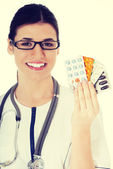 Young female doctor with pills. — Stock Photo