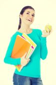 Beautiful young student with files and apple. — Stock Photo